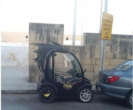 Mini Batmobile. Bruce Wayne does have a budget to manage now.. no more batman movies ... no more budget ... MINI batmobile